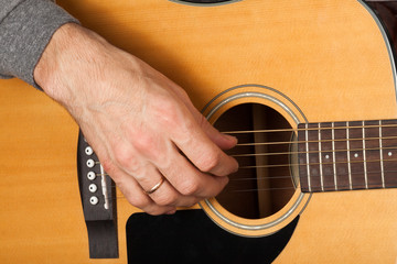 Man's hand playing the guitar.