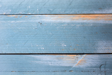 Vintage blue wood background with peeling paint.