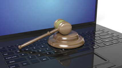 3D rendering of gavel on laptop's keyboard