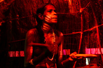 Yirrganydji Aboriginal woman play Aboriginal music with Clapstic