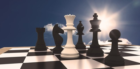Composite image of white queen standing with black chess pieces