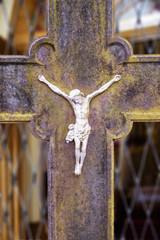 Metal crucifix on an old metal cross