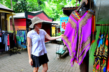 Woman shopping at the Original Rainforest  Market in Kuranda Que