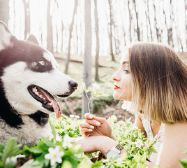 girl with his big dog playing outdoors