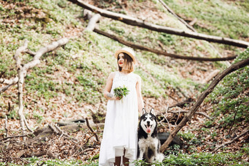 Girl and her dog  actively spend time in wood