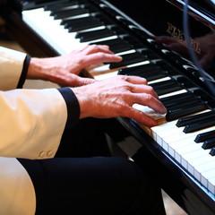piano/piano player playing his piano