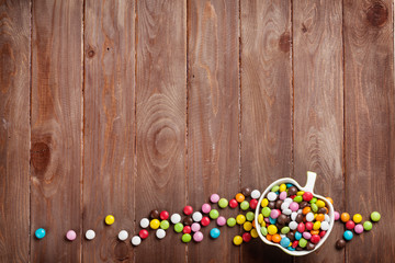 Colorful candies over wood