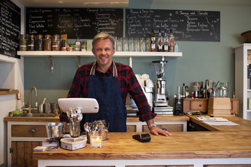 Portrait Of Owner Standing In Coffee Shop