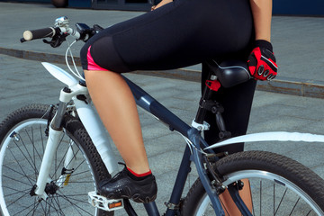 beautiful female legs with bicycle outdoors