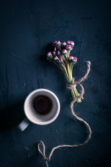 Table with a cup of coffee and flowers