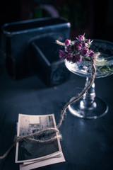 Table with a vase with flowers and photographs