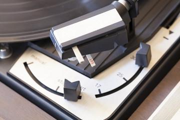 vintage record player macro close-up, buttons dials, stylus, controls, vinyl detail