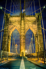 Wall Mural - Beautiful Brooklyn Bridge in New York City lit up at night