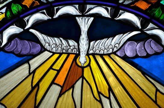 stained glass window depicting Pentecost