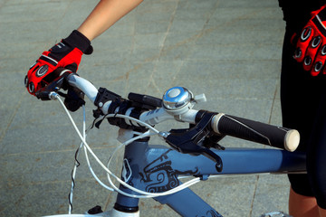 charming woman hands with bicycle