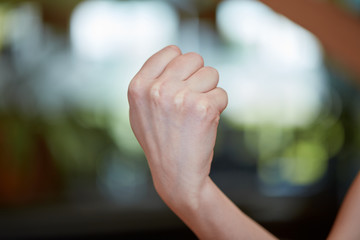 Caucasian young woman showing fist
