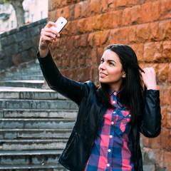 beautiful girl on the street makes selfie