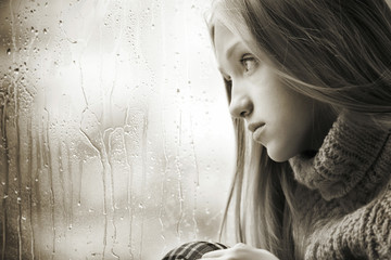 Rainy Day: sad Girl on the Window Black And White