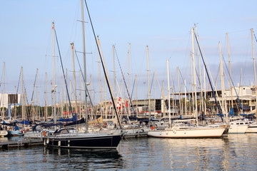 motorboats and yachts in harbour on the sunset