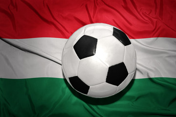 black and white football ball on the national flag of hungary