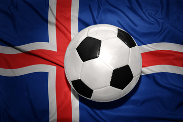black and white football ball on the national flag of iceland