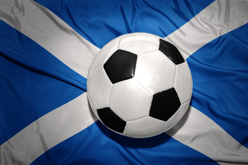 black and white football ball on the national flag of scotland
