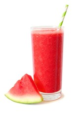 Glass of healthy watermelon juice isolated on a white background with melon slice