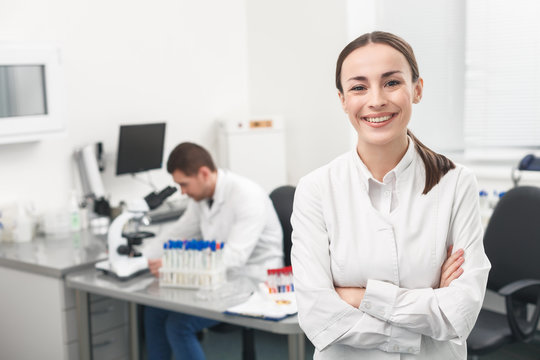 Cheerful female researcher is evincing positive emotions