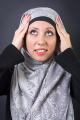 Muslim woman adjusting her headscarf