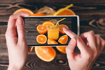 Hands Taking Photo of Oranges. Technology Concept