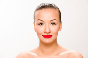 Brown sleek hair beautiful woman with with red lips looking at c