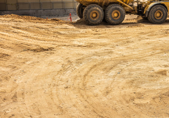 Construction site dirt with tire track markings
