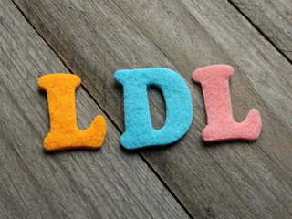 LDL (Low-density lipoprotein) acronym on wooden background
