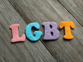LGBT (lesbian, gay, bisexual, transgender) acronym on wooden background
