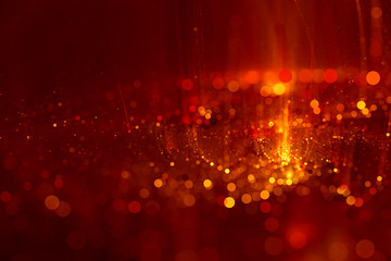 Abstract background red bokeh circles. Beautiful background with confetti particles