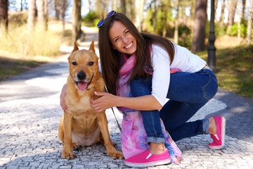 Casual brunette female with her brown dog.