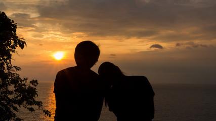 couple enjoying the sunset on the beach...