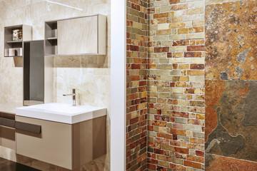 Luxury bathroom interior design. Stone wall