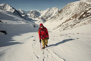 Tourist walking in snow high mountain top. Extreme winter Sport outdoor