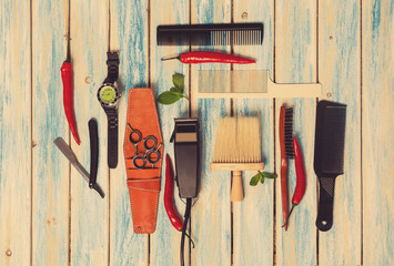 Hair Salon Equipment set for man on blue wood background. Spring, summer, mint and pepper, classically styled straight razor