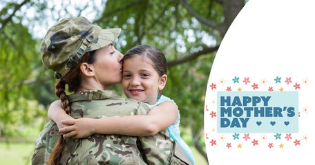 Composite image of mother in army uniform kissing daughter