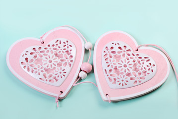 two hearts on mint color background