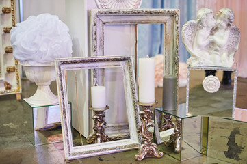 old photo frames and candles with decorations for studio