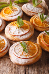 Freshly baked cookies with oranges and mint close-up. Vertical