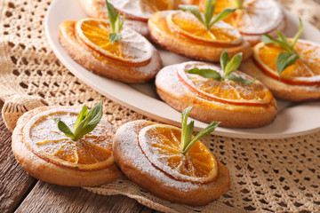 almond cookies with citrus close-up on a plate. horizontal
