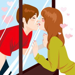 Cute young couple Kissing through glass window with love