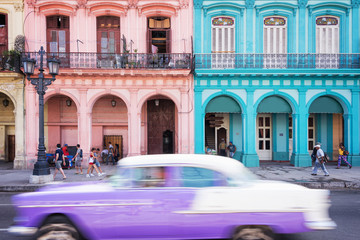 Wall Murals Havana Classic vintage car and colorful colonial buildings in the main street of Old Havana, Cuba