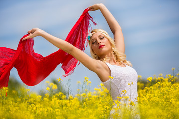 Beautiful happy girl having fun on the yellow field,