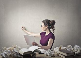 Writer taking notes
