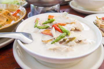 Chicken in coconut milk soup with chilly and lemon and galangal soup, Thai call Tom Kha Kai is delicious Thai food.